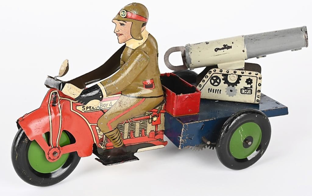 Tying for the sale's top lot at $21,850 was this prototype Marx military motorcycle with mounted cannon. The auction house said the spring-loaded cannon was functional and could shoot a projectile. It measured 10½ inches long and featured hand painted details. The result is an auction record for any Marx toy.