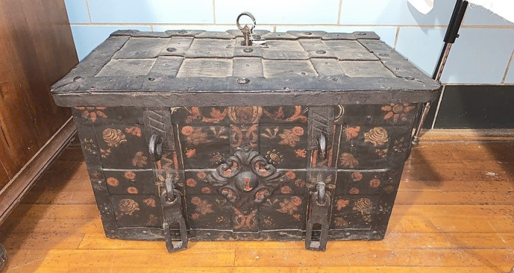"""According to early family ledgers, the Livezey family was engaged in trade in both the West Indies and China from about 1780 to 1820. This iron mounted paint-decorated chest measured 18 by 30 by 17 inches and was described in the catalog as """"extremely heavy."""" In addition to a colorful painted exterior, the interior featured island-themed decoration suggesting that this may have originated there. JR Russum said the condition was excellent for its age; it sold to a bidder in the room, from Maryland's Eastern Shore, for $6,900."""