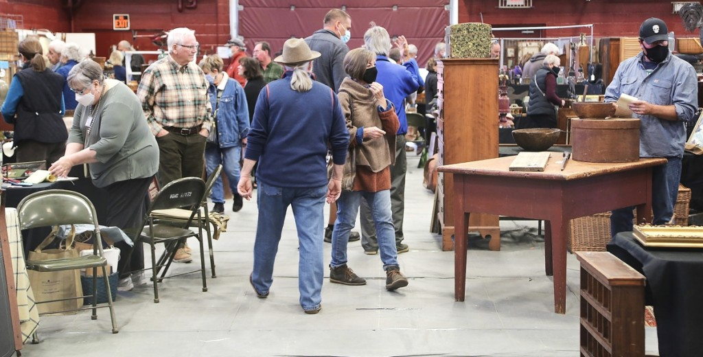 Buyers wandered through the aisles shortly after the show opened. —Black River Antique Show