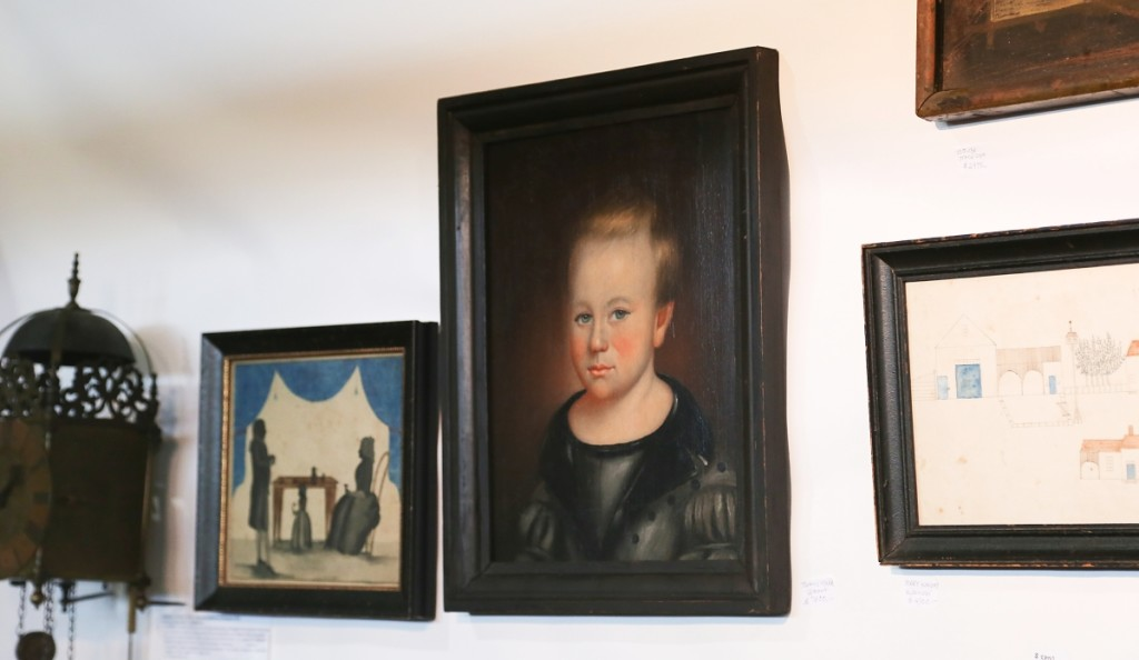 Itinerant Vermont folk artist Thomas Ware painted this portrait of a young boy. It was with Antiques Associates at West Townsend, West Townsend, Mass.   —Antiques at the Icehouse