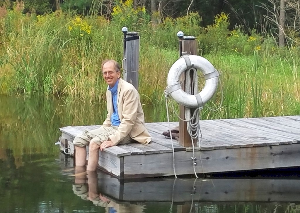 Philip sitting on the couple's friend Ed Dixon's dock at a lake in northern Pennsylvania. To Lisa, this photo captures Philip's love of the water and his joyful spontaneity. Courtesy Lisa Minardi.
