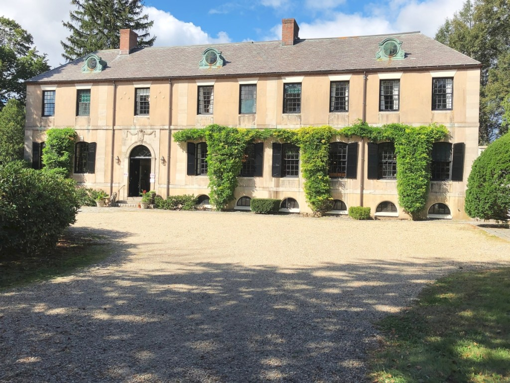 The entrance to the large, 11-bedroom home. The home and the 40-acre property are now under contract.