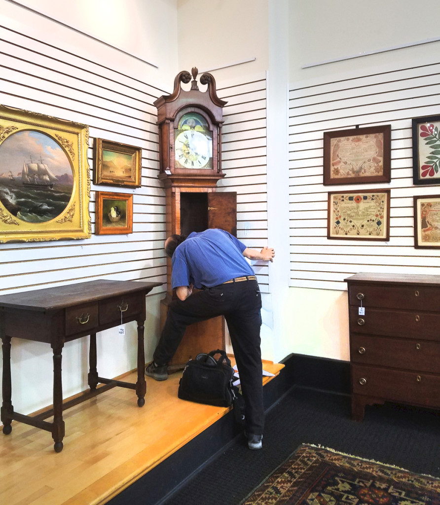 Philip inspecting a clock at Pook & Pook in June 2020. Courtesy Lisa Minardi.