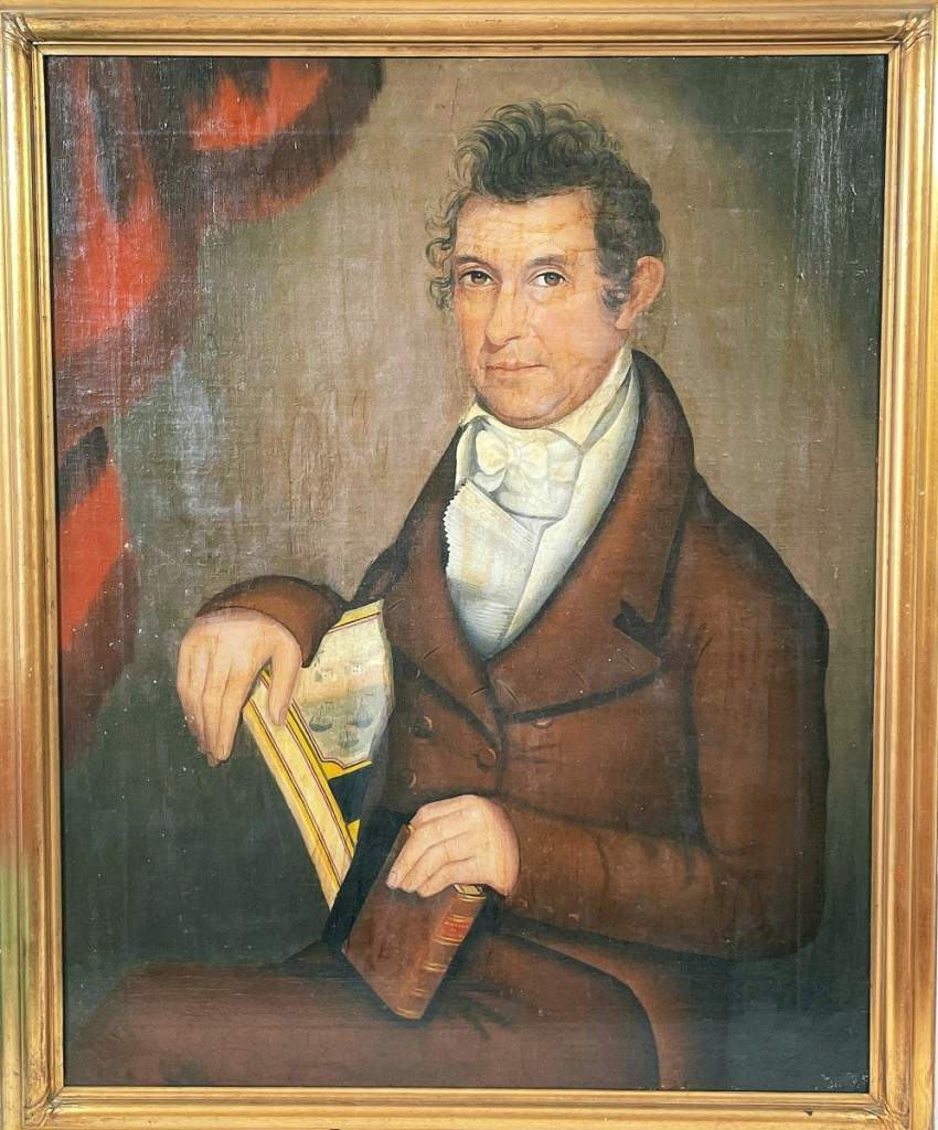 """Leading the sale was a portrait by Ammi Phillips (1788-1865), a """"Portrait of William Northrop Bentley."""" From the Bentley estate, the painting brought $42,000 from David Schorsch, the Woodbury, Conn., dealer. Schorsch noted that the detail of Bentley depicted holding a book titled The Horrors of Slavery is """"an extremely rare inclusion in any American portrait, folk or academic, and speaks to the degree that abolition played in this man's identity and his life."""""""